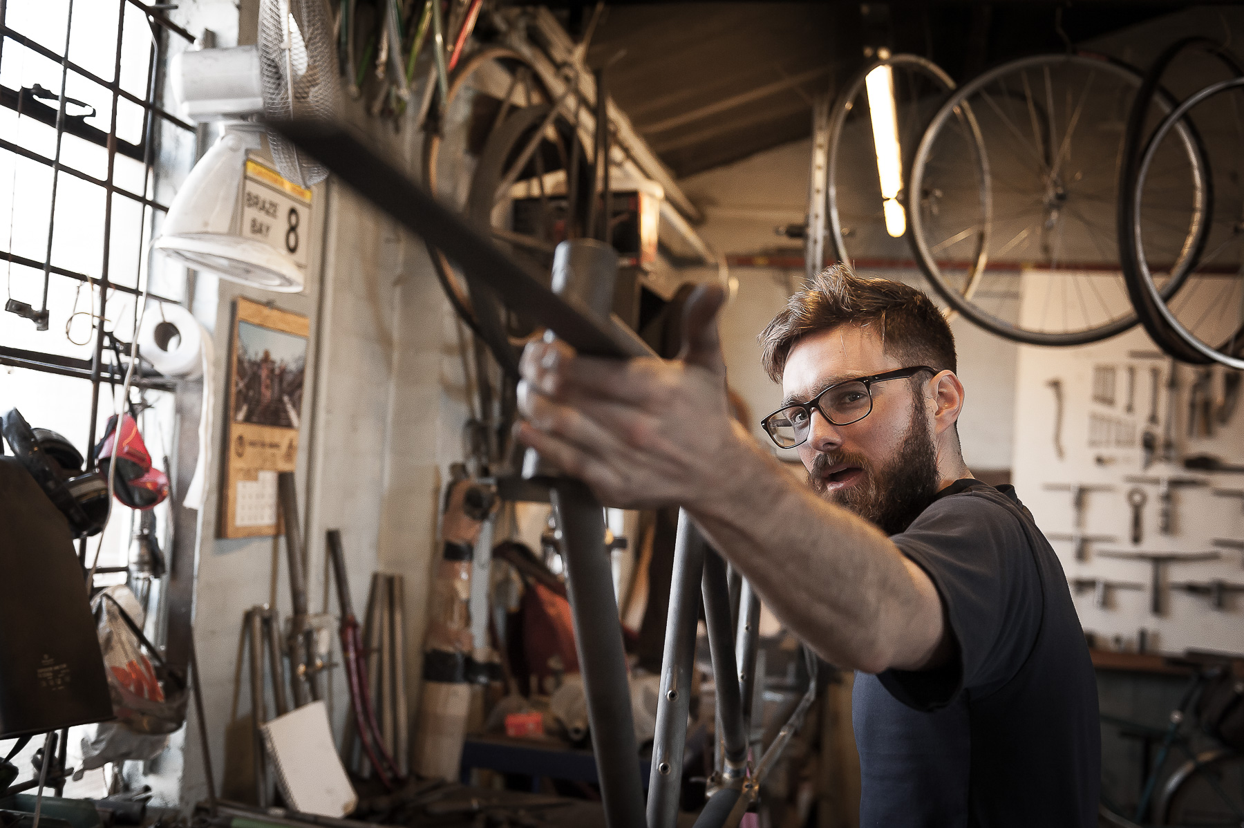 Man hand makes bicycle in Mercian Cycle workshop