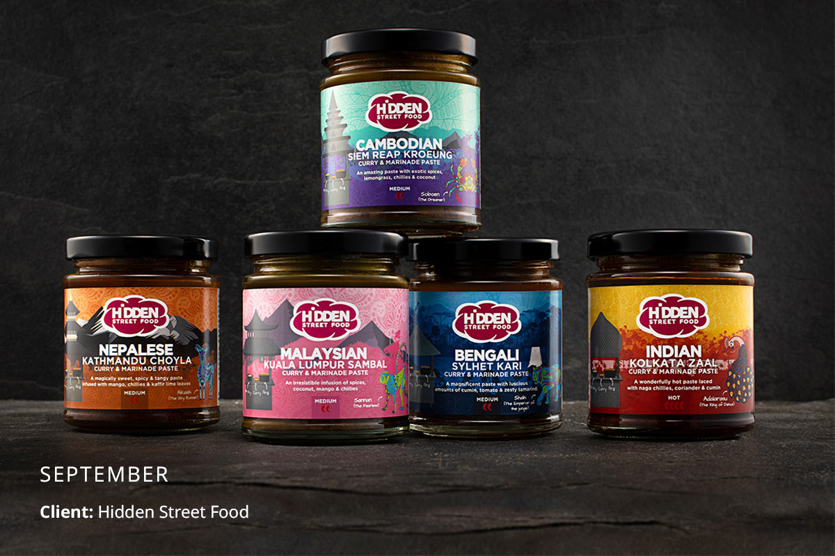 Hidden Street Food product range shot on a grey slate background
