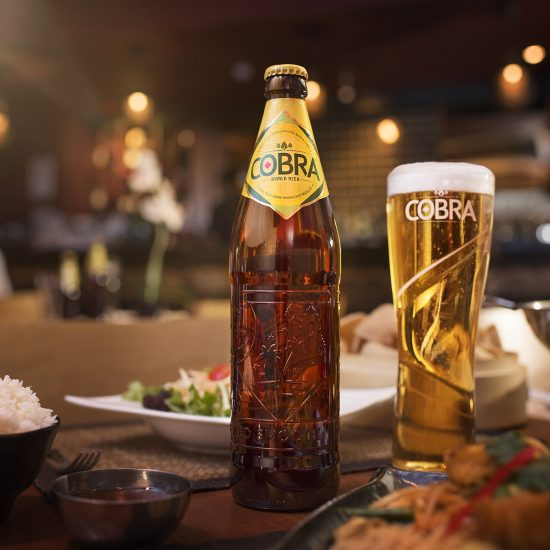Bottle and pint of Cobra beer in a Chinese restaurant