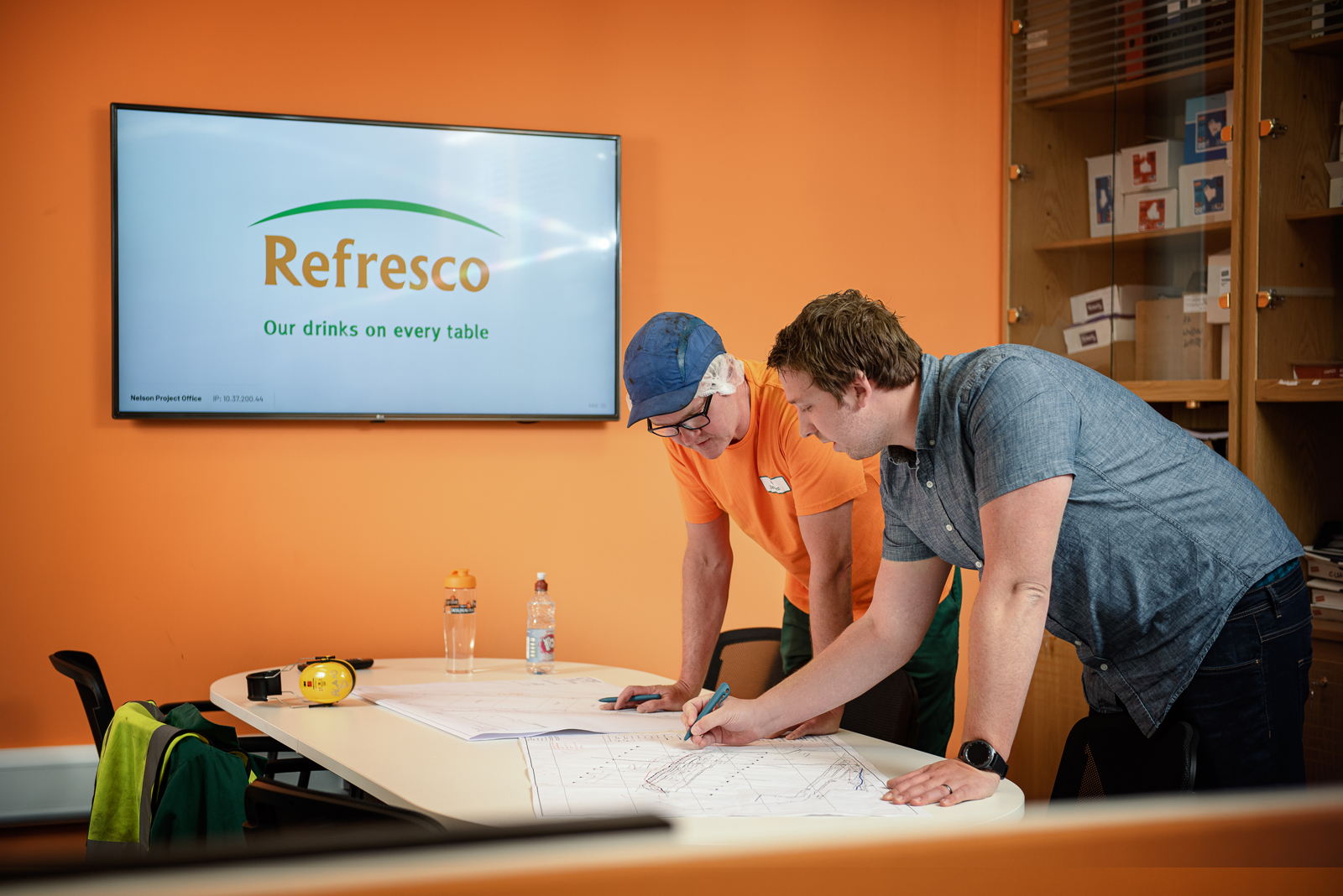 Team discuss a project in the boardroom at Refresco